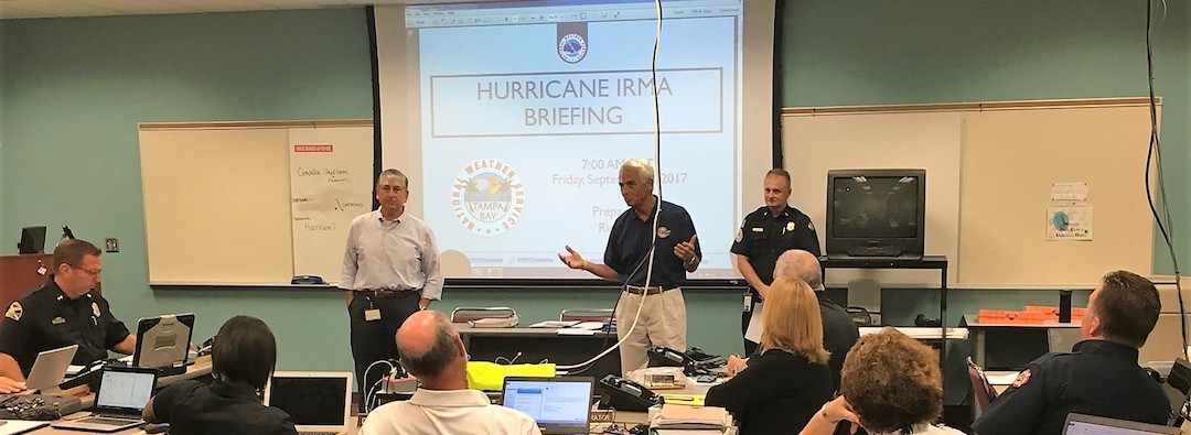 Rep. Charlie Crist talking to constituents during a Hurricane Urma briefing.