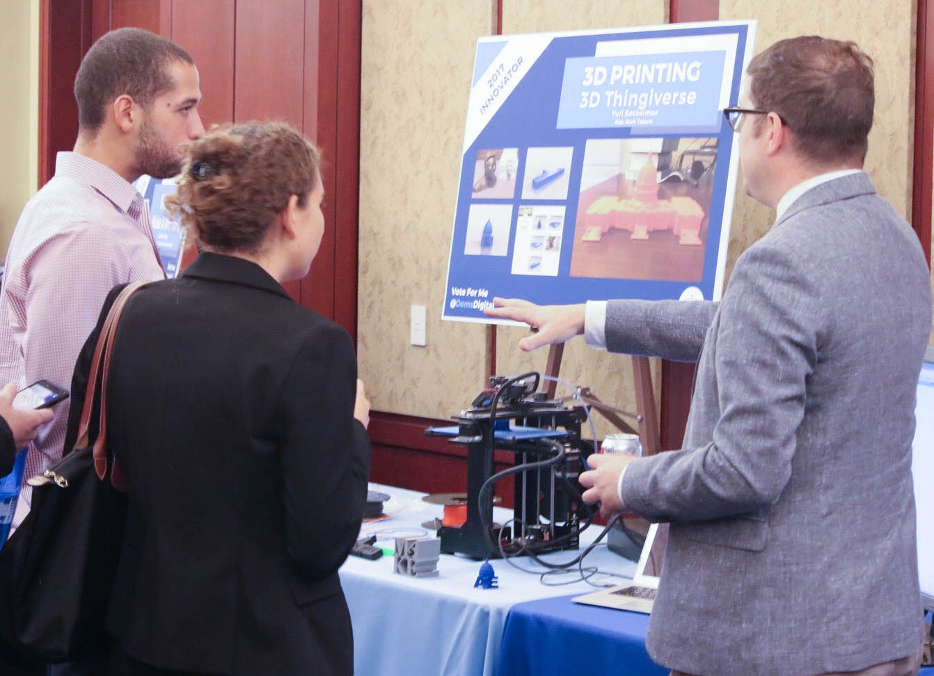 Deputy Chief of Staff and Legislative Director Yuri Beckelman shows off his team's 3D printer at the recent Digital Day on the Hill.