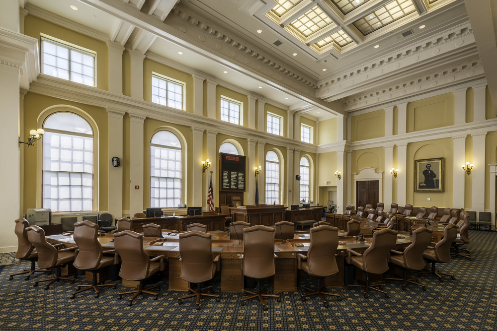 The Maine state senate chamber is shown, where senators like Cathy Breen operate as part of a citizen legislature.