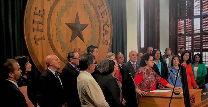 Texas Rep. Celia Israel speaks with individuals.