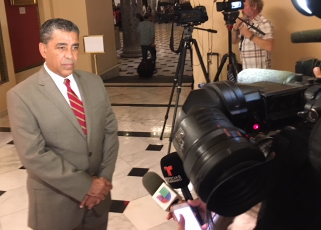 Rep. Adriano Espaillat (D-NY-13) in front of a news camera.