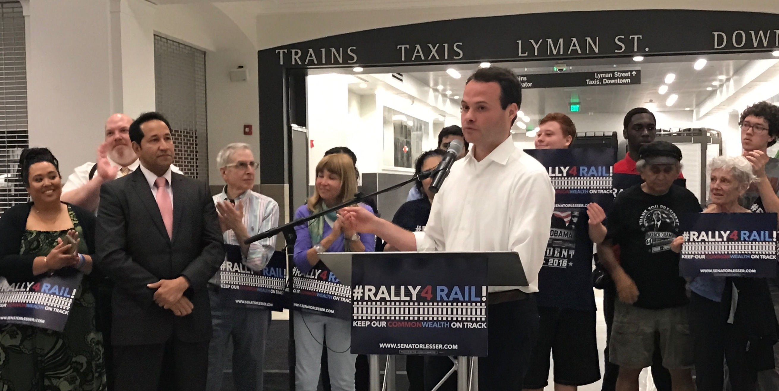 An image of Sen. Eric Lesser (D-MA) standing amongst a small crowd of individuals.