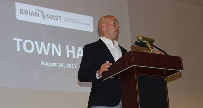 Congressman Brian Mast (R-FL-18) giving a speech to a crowd.